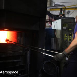 Removing components from a furnace ready for forging