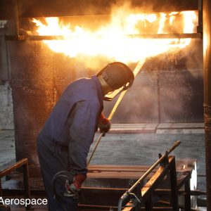 Lubricating dies, in our 12,000-tonne hydraulic press, prior to forging