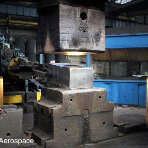 After heating, a billet is pre-formed prior to die forging
