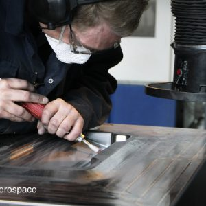 Highly-skilled tooling technician producing a die